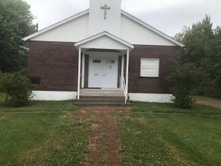 Le Comité consultatif régional ethnoculturel du SCC (région de l'Atlantique) s'associe aux délinquants et à la communauté pour restaurer le presbytère de l'église locale.
