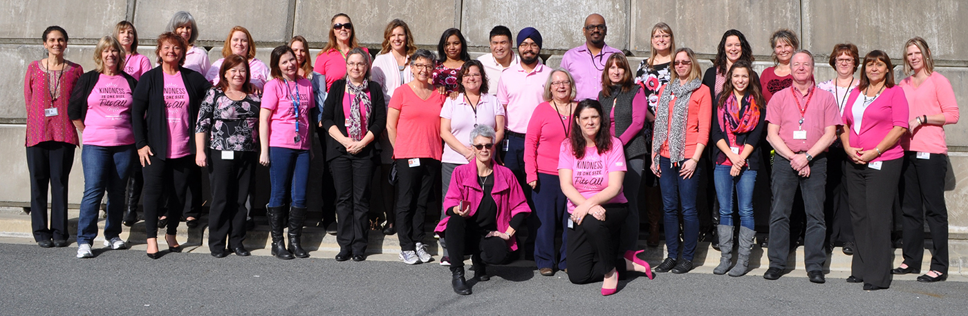 A group photo of Pacific Region Headquarters staff wearing their pink shirts on Pink T-Shirt Day.