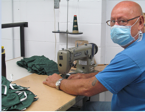 Inmates make reusable masks for the less fortunate