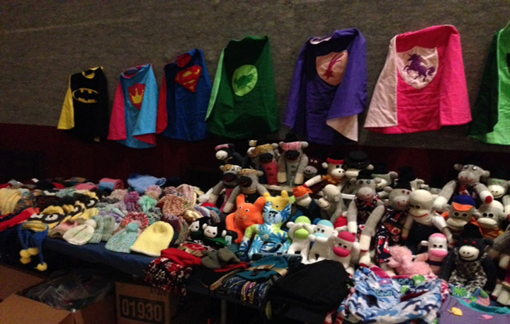 A photo of toys, hats, mittens, and capes made for children at the Christmas gathering on December 18, 2015