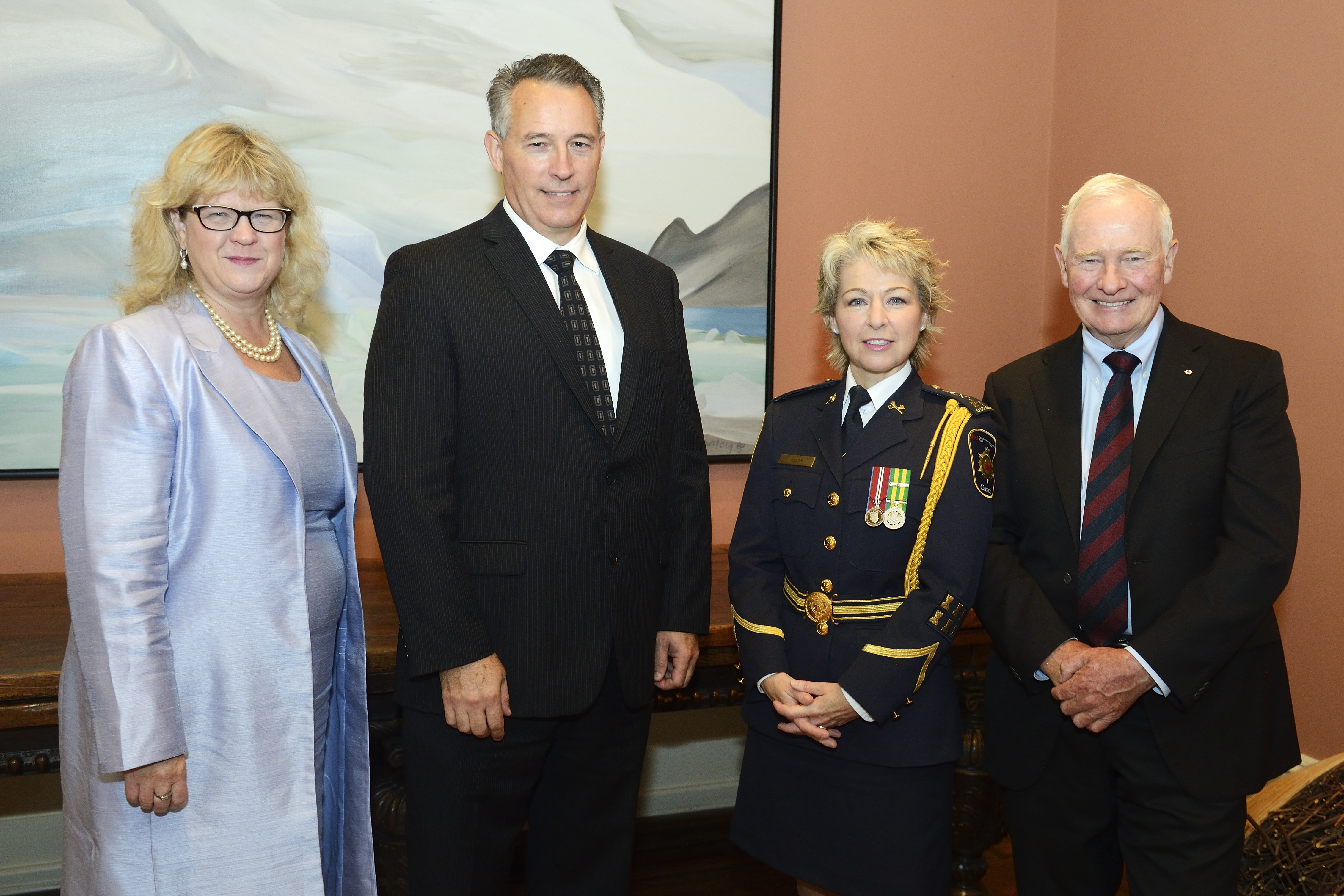 A photo of Dr. Jeremy Mills standing with Janice Charette, Clerk of the Privy Council, His Excellency the Right Honourable David Johnston, Governor General of Canada, and Senior Deputy Commissioner Anne Kelly.