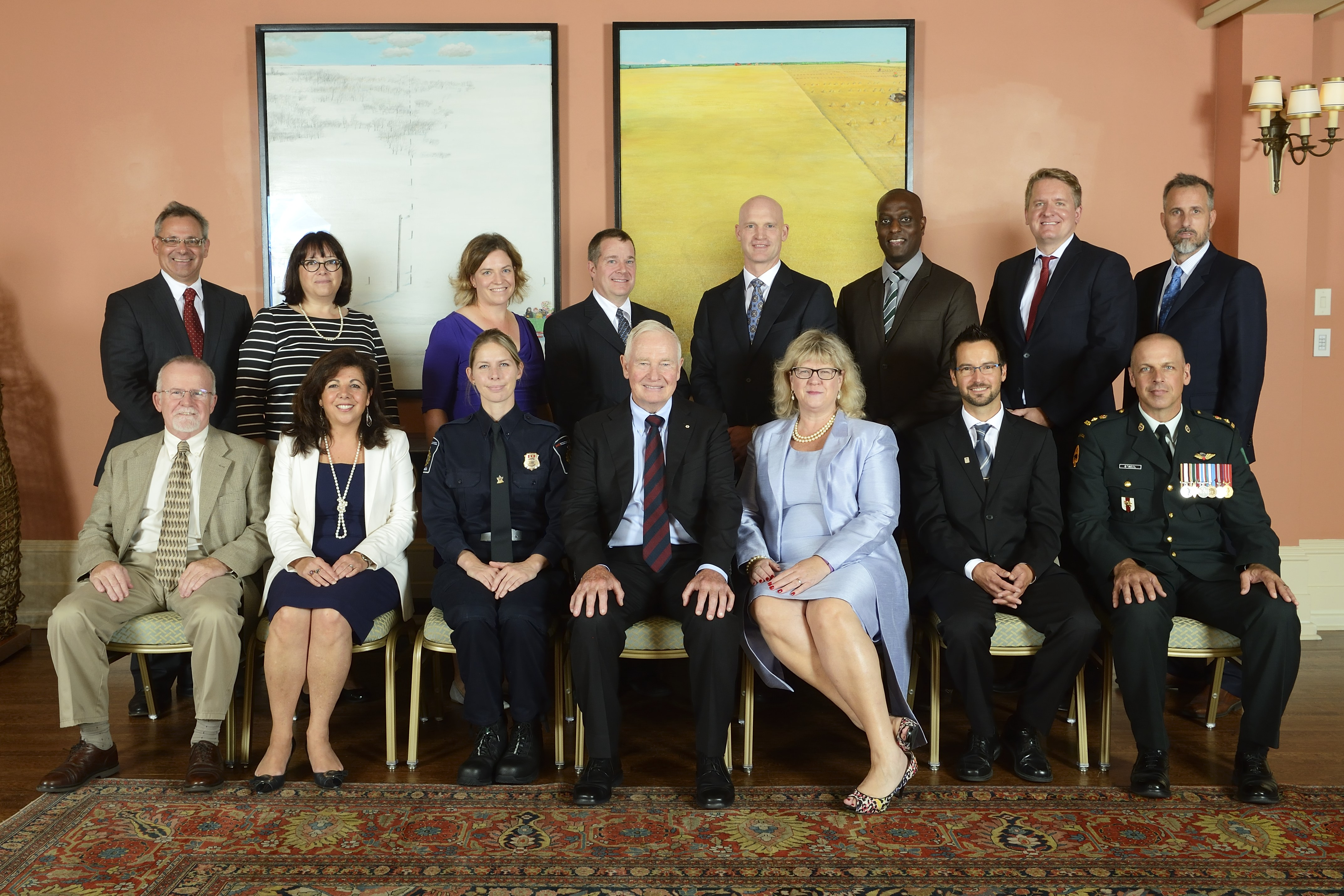 A photo of Martin Gagnon sitting with Janice Charette, Clerk of the Privy Council, His Excellency the Right Honourable David Johnston, Governor General of Canada, and the interdepartmental Ebola Response Team.