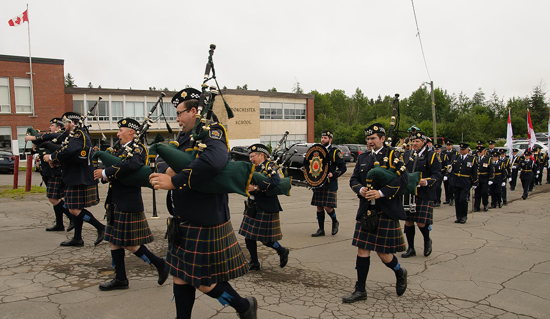 A photo of CSC's pipes and drums unit beginning their parade through Dorchester Village.