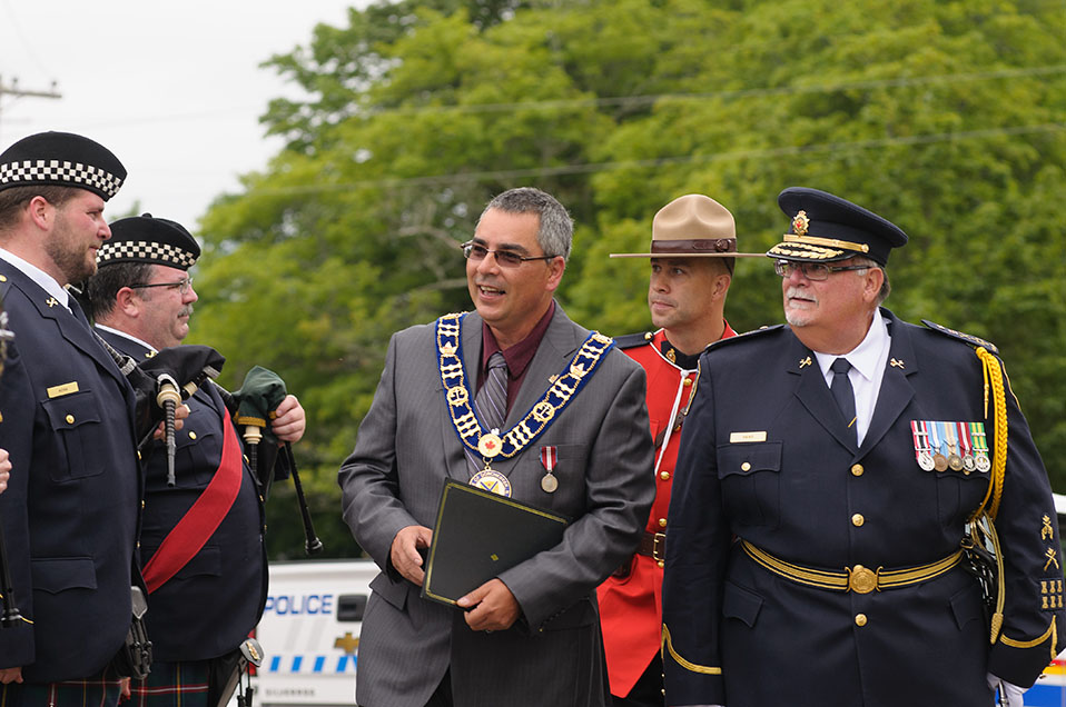 A photo of CSC Commissioner Don Head walking with the mayor of Dorchester Village.