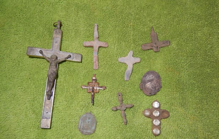 A photo of a collection of crosses and other religious items