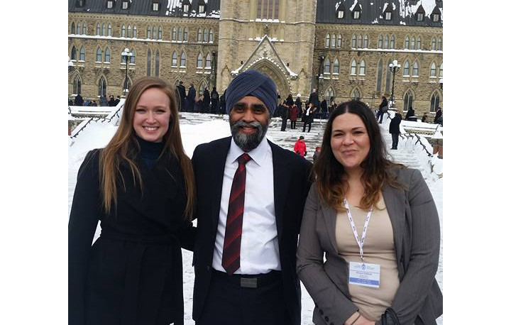 A photo of Allison and a fellow group leader with Minister of National Defence Harjit Singh Sajjan