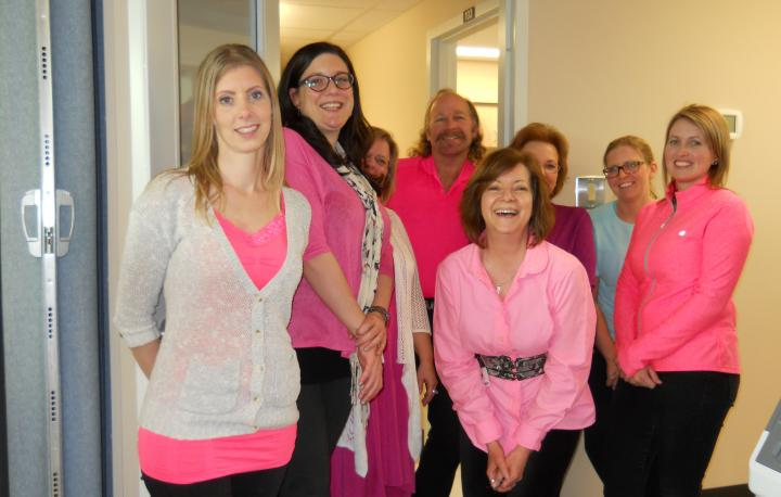 A group photo of staff at the Pacific Region Community Corrections Administration Office on Pink T-Shirt Day.