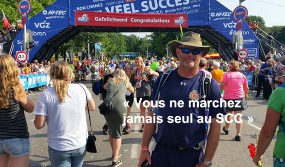 """Photo de Doug Holsworth avec le texte """"Vous ne marchez jamais seul au SCC"""""""