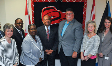 A photo of CSC officials, including Commissioner Don Head in the center, with members of the Bahamian delegation