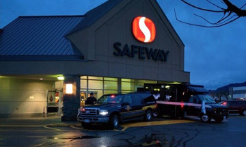 A photo of two CSC vehicles parked outside a Safeway grocery store in Chilliwack, British Columbia.