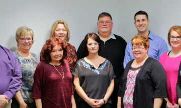 A group photo of Commissioner Head standing with Victim Services Officers in the Prairie Region