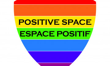 A photo of the Positive Space logo. It is a rainbow colored shield.