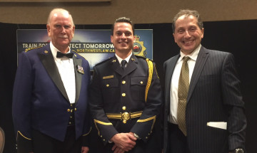 A photo of Retired Winnipeg Chief of Police, Herb Stephen, Robert Bonnefoy, and Northwest Law Enforcement Academy CEO Victor Popow.