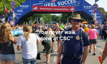 "A photo of Doug Holsworth with the text ""You never walk alone at CSC"""